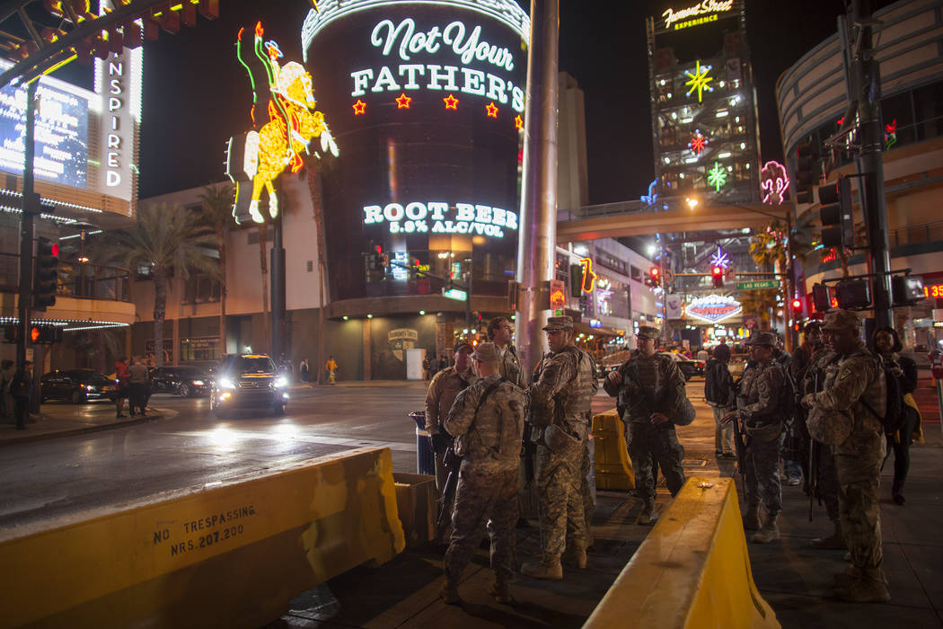 Members of the National Guard stand watch for New Year's Eve crowds in downtown Las Vegas, Sunday, Dec. 31, 2017. Rachel Aston Las Vegas Review-Journal @rookie__rae