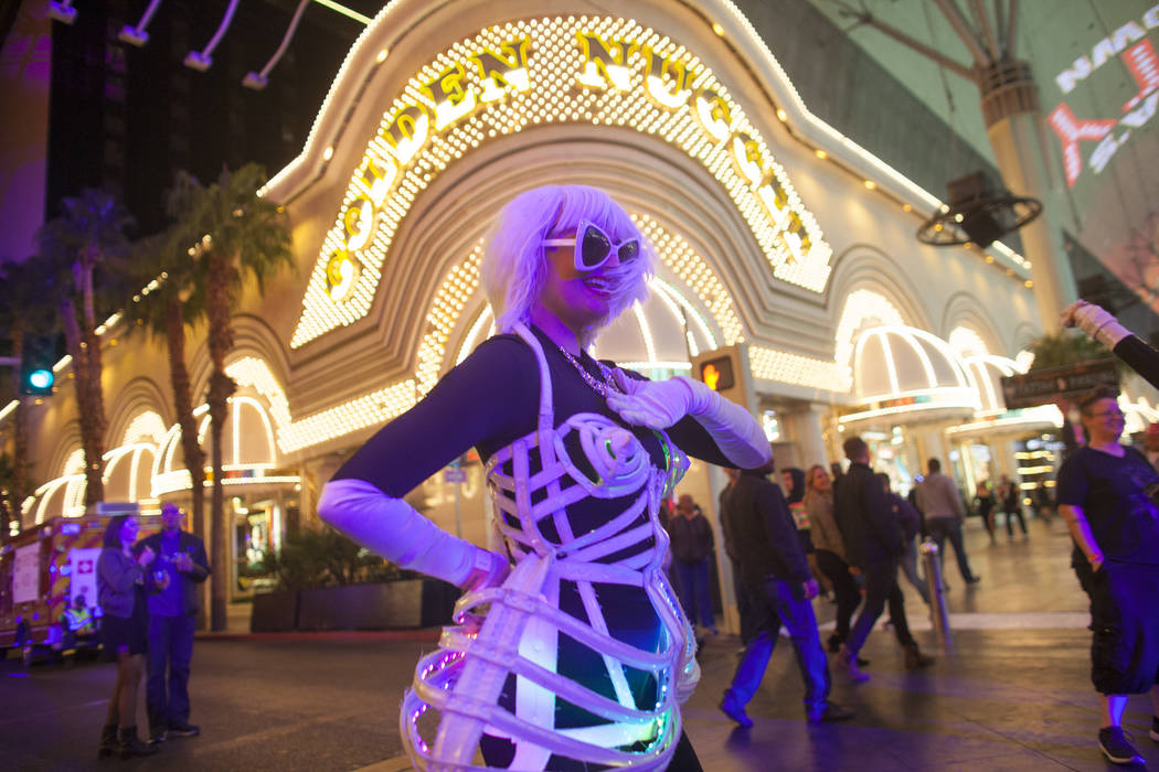 A dancer from the Champagne Creative Group dances at the Fremont Street Experience in Las Vegas, Sunday, Dec. 31, 2017. Rachel Aston Las Vegas Review-Journal @rookie__rae