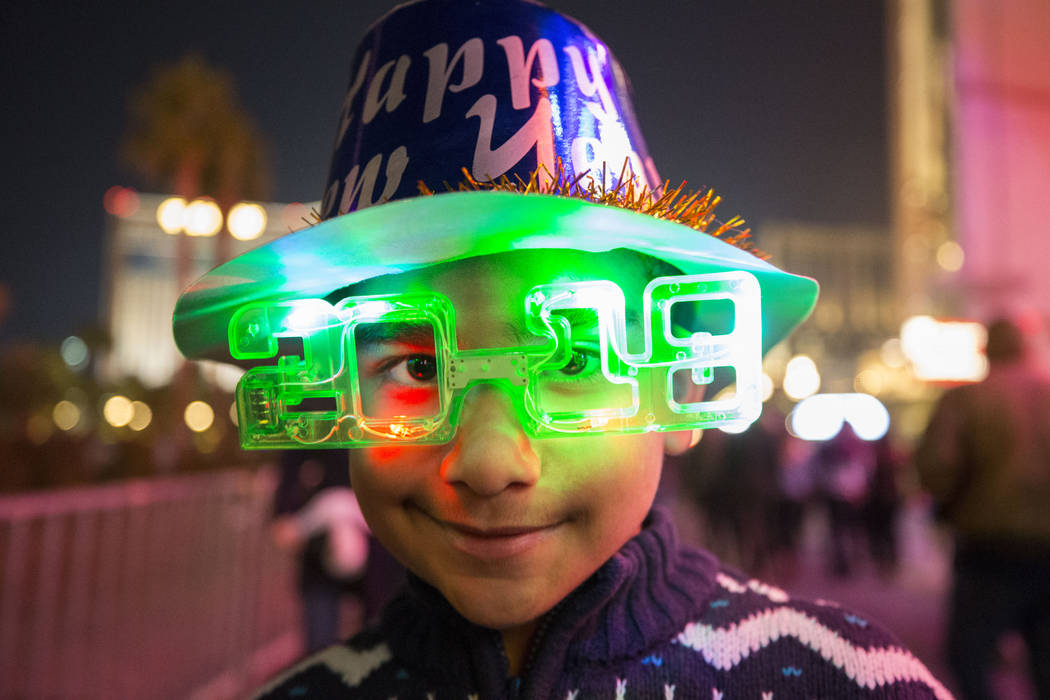 Taylor Matos, 7, of Florida walks the Strip with his family on New Year's Eve, Sunday, Dec. 31, 2017. Richard Brian Las Vegas Review-Journal @vegasphotograph
