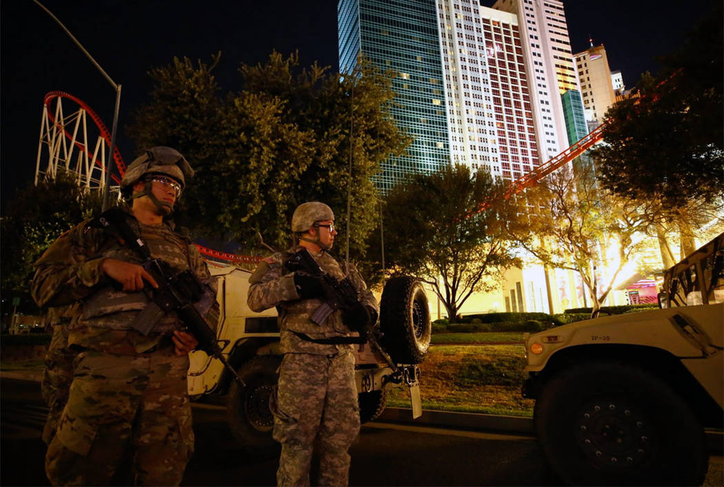 Nevada National Guard soldiers secure an area near New York-New York on the Las Vegas Strip on Dec. 31, 2017. (Richard Brian/Las Vegas Review-Journal)