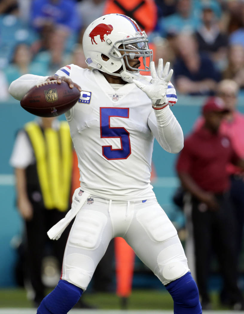 Buffalo Bills quarterback Tyrod Taylor (5) looks to pass, during the first half of an NFL football game against the Miami Dolphins, Sunday, Dec. 31, 2017, in Miami Gardens, Fla. (AP Photo/Lynne Sl ...