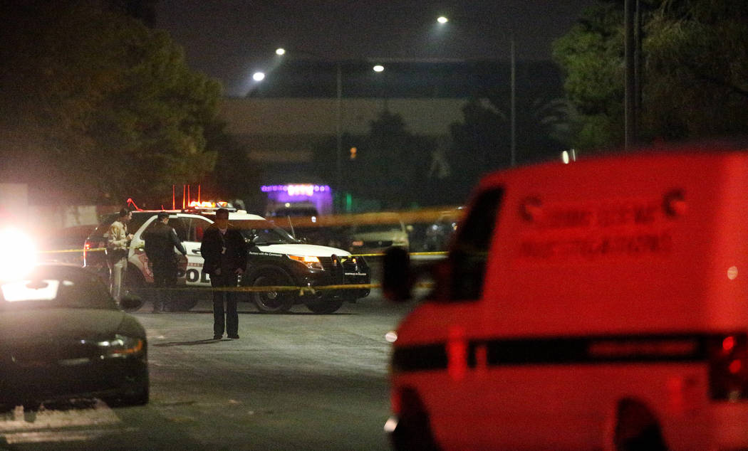 Las Vegas police investigate the scene in the 4800 block of Chantilly Avenue, near Charleston and Nellis boulevards where a man died in a drive-by shooting. It was the 169th homicide investigated  ...