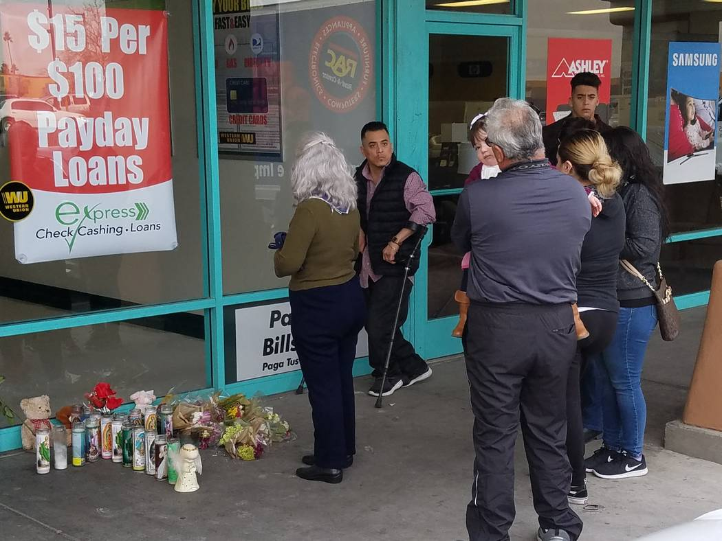 Family and loved ones of Celia Luna gather outside Checks Cashed in Las Vegas on Thursday. (Mike Shoro/Las Vegas Review-Journal)