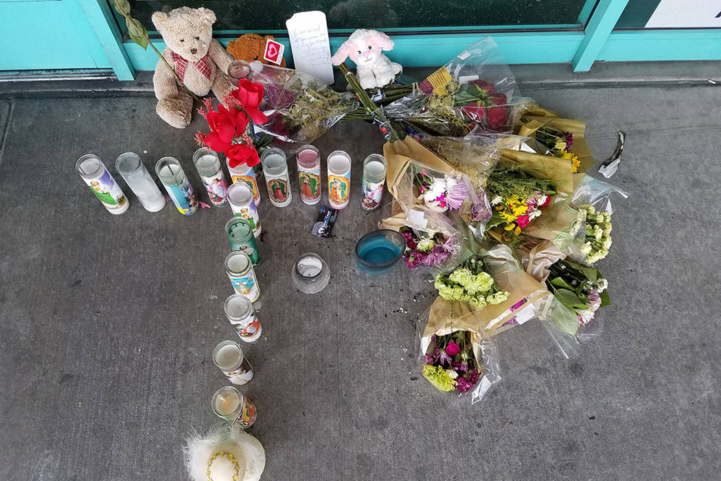 A memorial to Celia Luna is seen outside Checks Cashed in Las Vegas on Thursday. (Mike Shoro/Las Vegas Review-Journal)