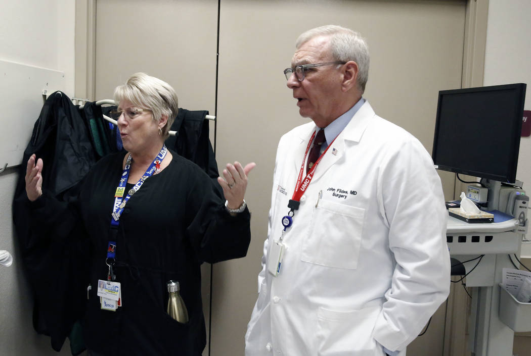 Dr. John Fildes, a trauma surgeon and University Medical Center's director of trauma, listens as Toni Mullan, a nurse, speaks during an interview with the Las Vegas Review-Journal at UMC's Trauma  ...