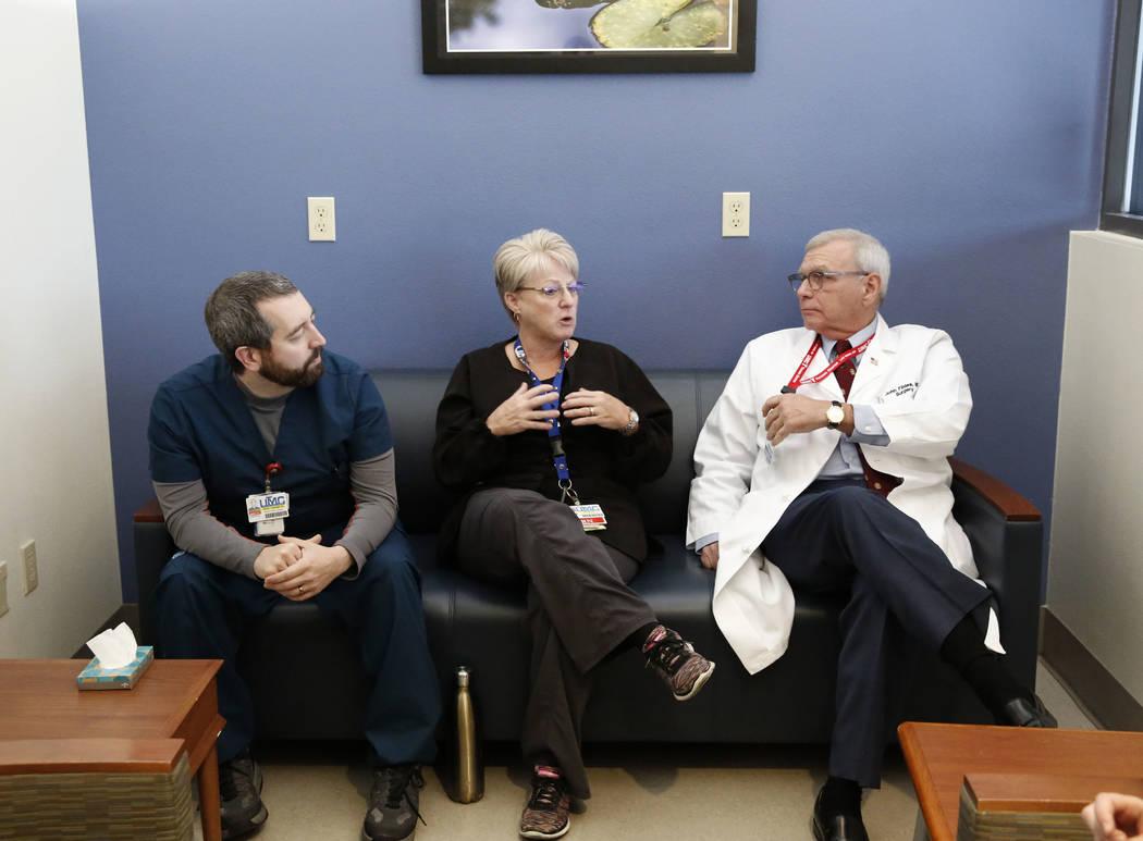 Toni Mullan, a nurse, center, speaks, as Joseph Bruno, registered nurse at UMC Trauma Center, left, and Dr. John Fildes, a trauma surgeon and UMC's director of trauma, right, look on during an int ...