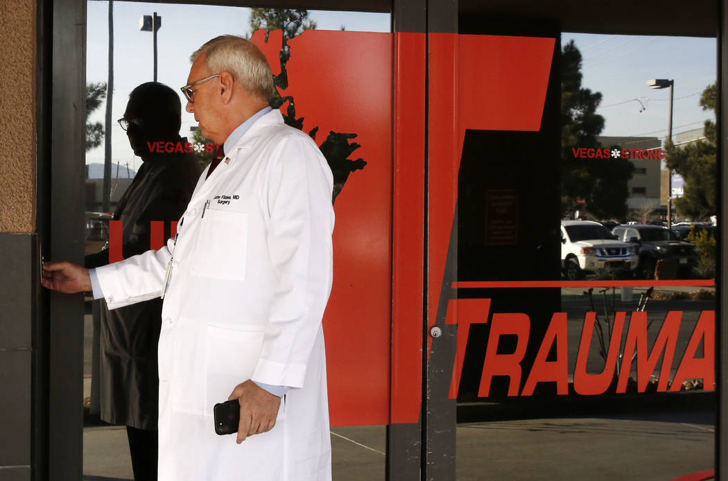 Dr. John Fildes, a trauma surgeon and University Medical Center's trauma director, opens the door as he leads a tour of UMC's Trauma Center on Thursday Jan. 18, 2017, in Las Vegas. (Bizuayehu Tesf ...