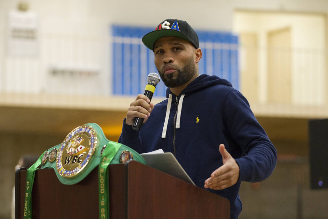 Boxer Ishe Smith speaks to students during a Clark County School District Peace Week assembly at Ed Von Tobel Middle School in Las Vegas, Thursday, Jan. 18, 2018. The event featured professional a ...