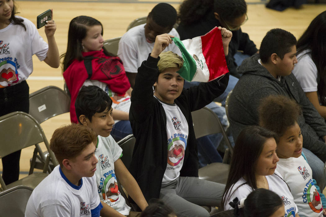 Angel Rojo, 13, waves a Mexican flag during a Clark County School District Peace Week assembly at Ed Von Tobel Middle School in Las Vegas, Thursday, Jan. 18, 2018. The event featured professional  ...