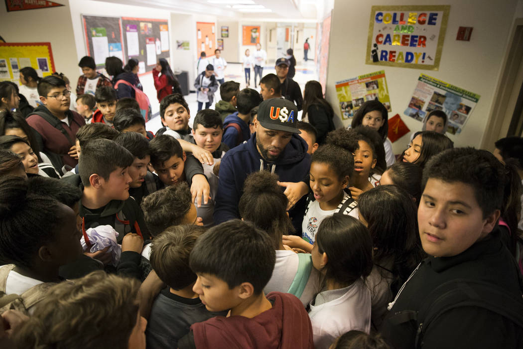 Boxer Ishe Smith signs autographs during a Clark County School District Peace Week assembly at Ed Von Tobel Middle School in Las Vegas, Thursday, Jan. 18, 2018. The event featured professional and ...