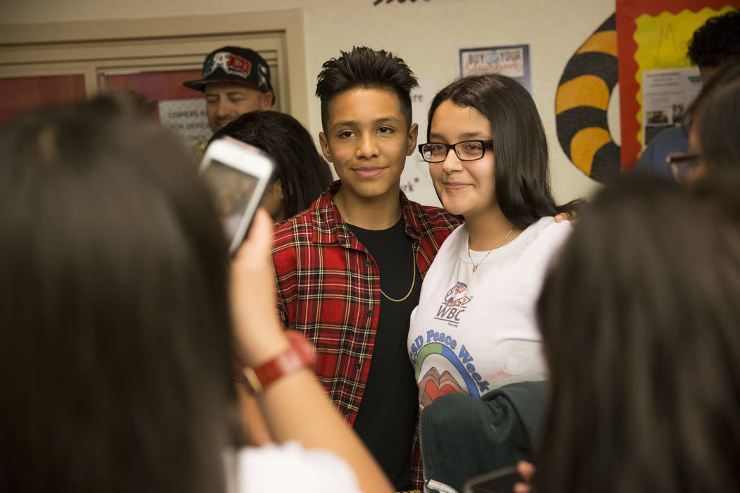 Amateur boxer Emiliano Vargas, left, take a photo with Ariana Yepez, 13, during a Clark County School District Peace Week assembly at Ed Von Tobel Middle School in Las Vegas, Thursday, Jan. 18, 20 ...