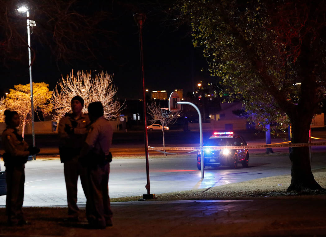 Police officers investigate a fatal shooting at Lewis Family Park in Las Vegas, Thursday, Jan. 18, 2018. Chitose Suzuki Las Vegas Review-Journal