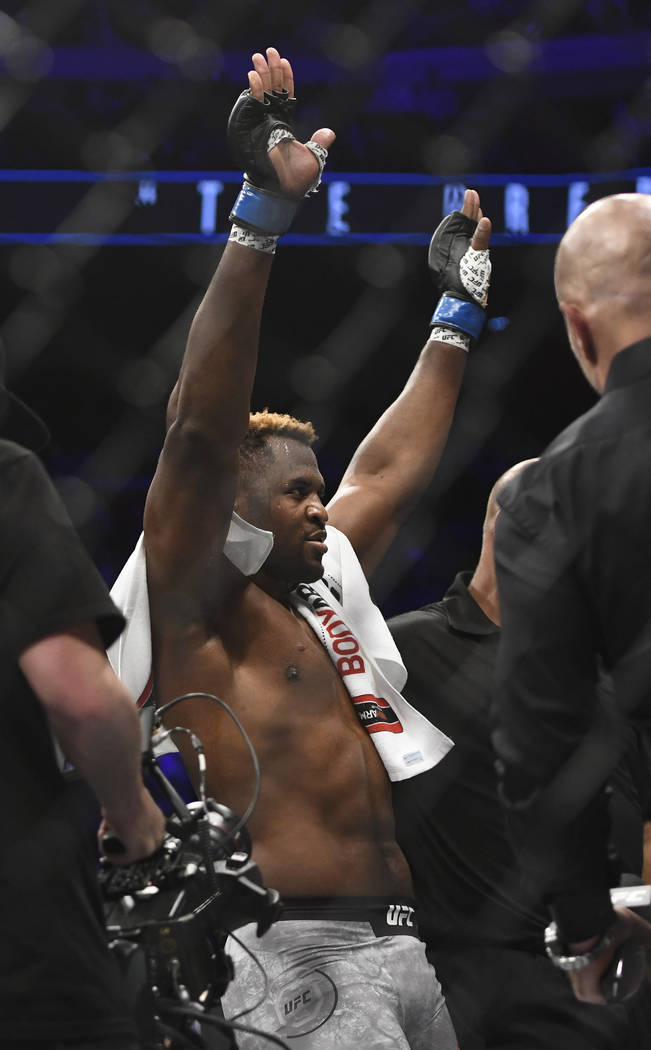 Francis Ngannou celebrates after knocking out Alistair Overeem in the first round during a UFC 218 heavyweight mixed martial arts bout, Saturday, Dec. 2, 2017 in Detroit. (AP Photo/Jose Juarez)