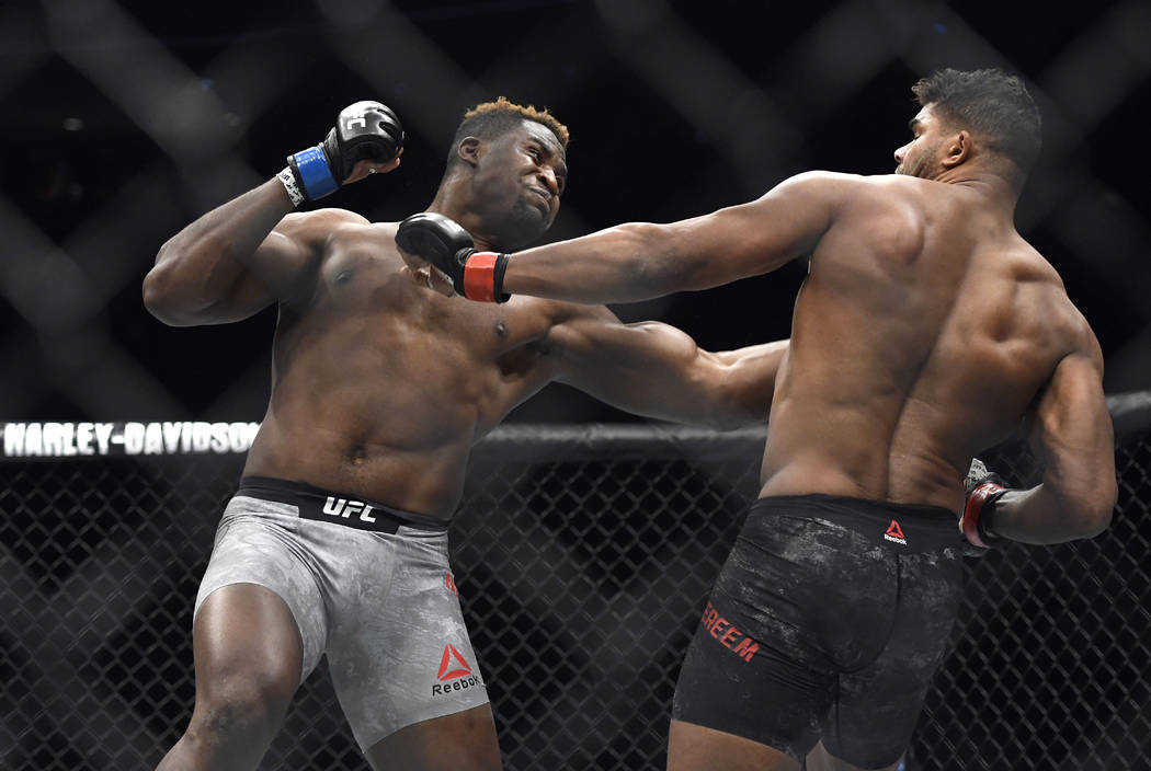 FILE- In this Dec. 2, 2017, file photo, Francis Ngannou, left, hits Alistair Overeem in the first round during a UFC 218 heavyweight mixed martial arts bout, in Detroit. Ngannou defeated Overeem b ...