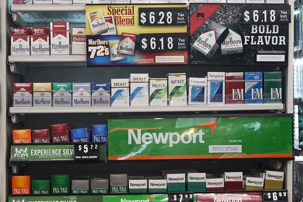 In this Thursday, May 18, 2017 file photo, packs of cigarettes are offered for sale at a convenience store in Helena, Montana. (Bobby Caina Calvan/AP)