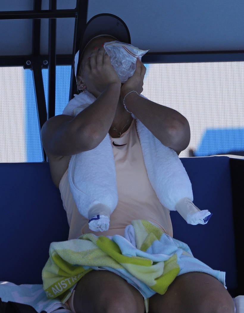 Ukraine's Marta Kostyuk holds a ice pack on her face during a break in her third round match against compatriot Elina Svitolina at the Australian Open tennis championships in Melbourne, Australia, ...