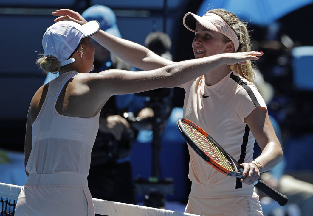 Ukraine's Elina Svitolina, right, is embraced by compatriot Marta Kostyuk after winning their third round match against compatriot at the Australian Open tennis championships in Melbourne, Austral ...