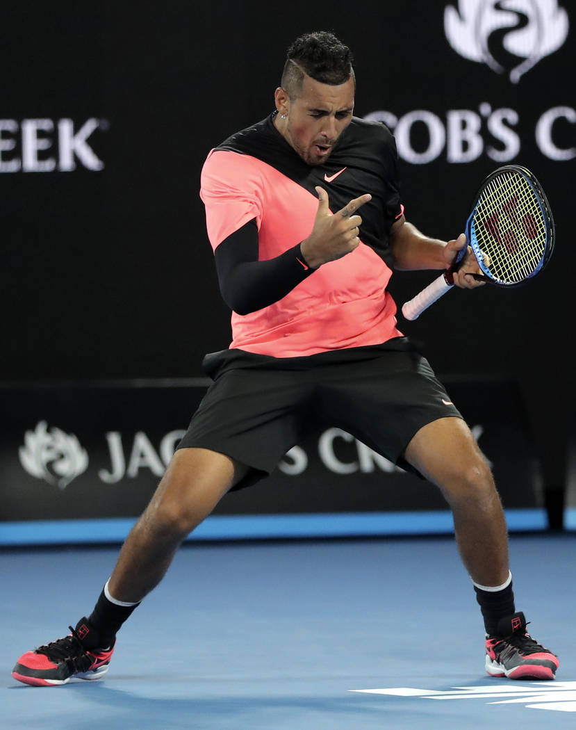 Australia's Nick Kyrgios celebrates after defeating France's Jo-Wilfried Tsonga during his third round match at the Australian Open tennis championships in Melbourne, Australia, Friday, Jan. 19, 2 ...
