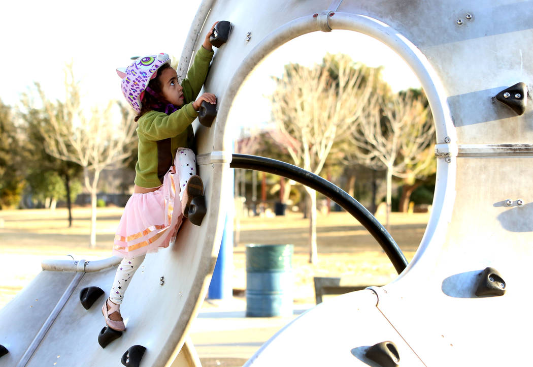 Zoé Tesfai, 4, plays at Sunset Park playground on Friday, Jan. 19, 2017, in Las Vegas. (Bizuayehu Tesfaye/Las Vegas Review-Journal) @bizutesfaye