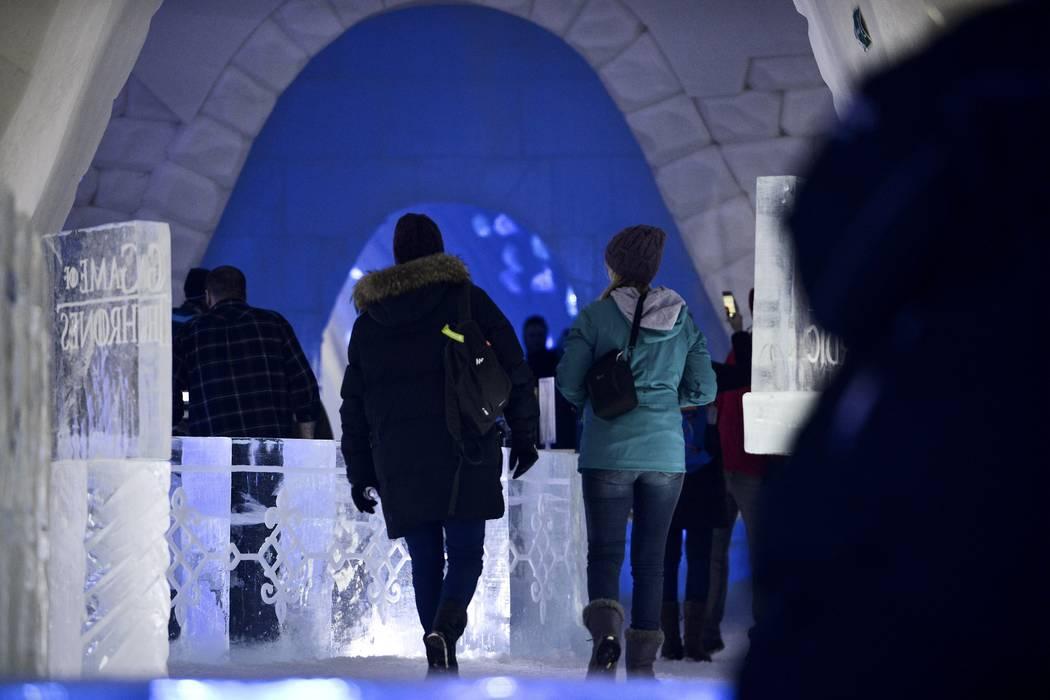 "Visitors walk inside a ""Game of Thrones""-themed ice hotel in Kittila, Finnish Lapland on Sunday Jan. 14, 2018. (Aku H'yrynen/Lehtikuva via AP)"