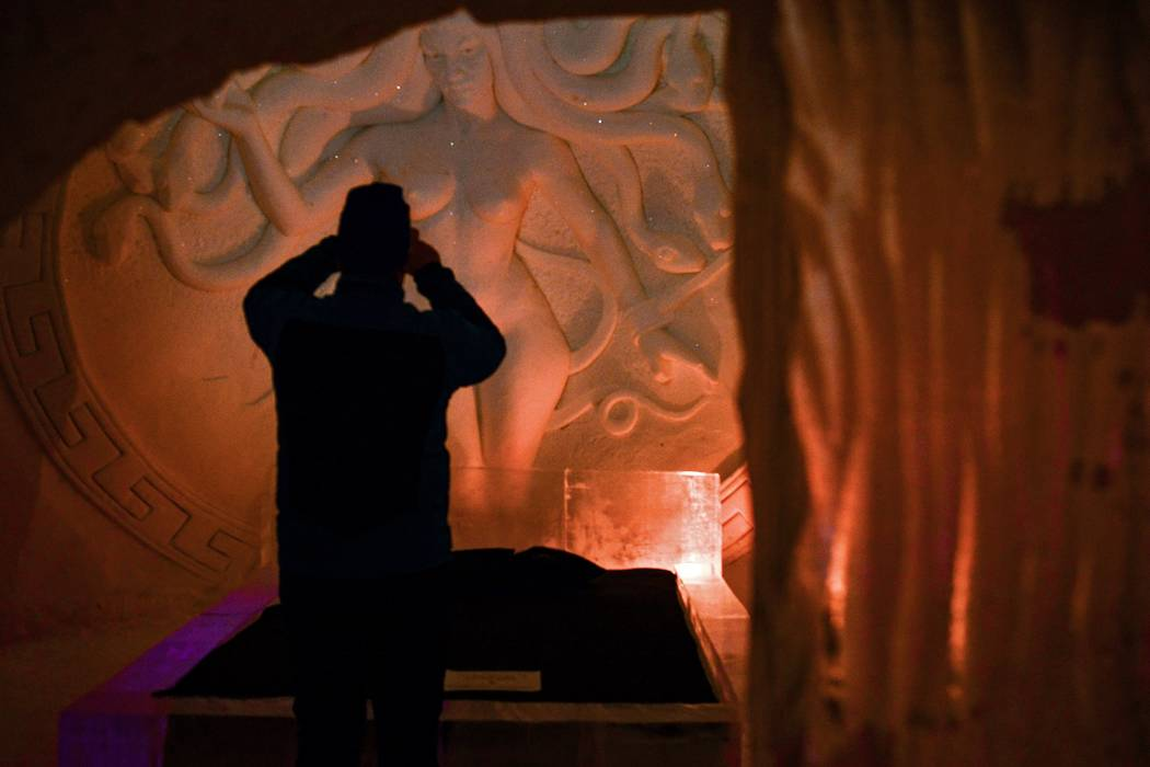"A visitor stands inside the ""Game of Thrones""-themed ice hotel in Kittila, Finnish Lapland on Sunday Jan. 14, 2018. (Aku H'yrynen/Lehtikuva via AP)"