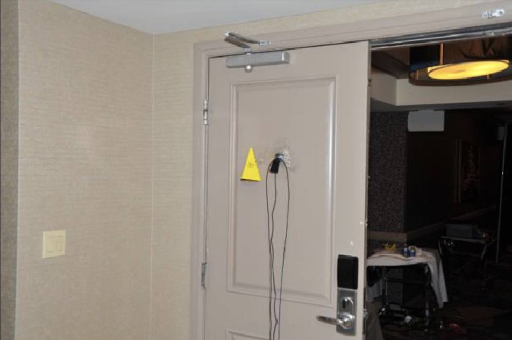 A surveillance camera mounted to the peephole of the room door. LVMPD.