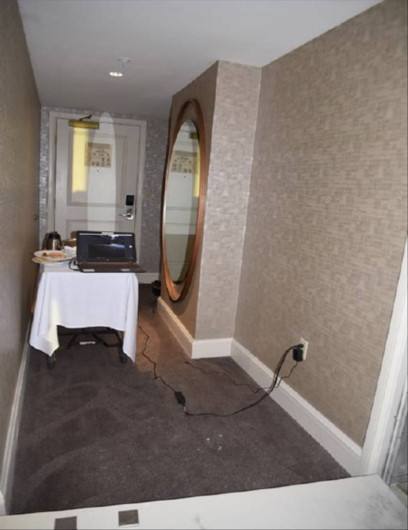 The hallway of room 32-134 with a food service cart and laptop connected to cameras in the hallway. LVMPD.
