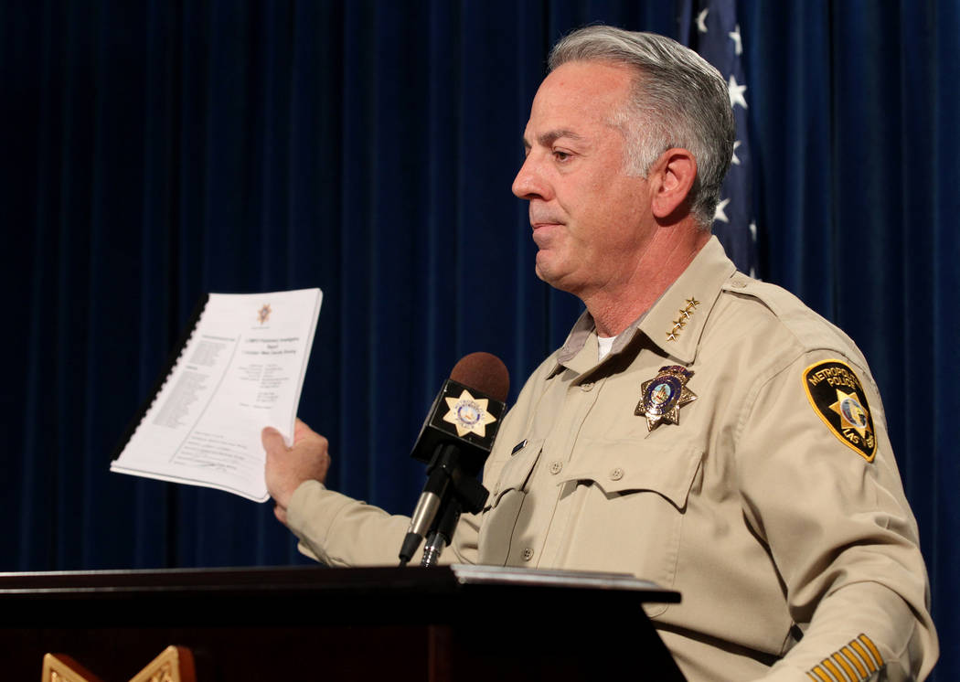 Clark County Sheriff Joe Lombardo shows a preliminary report to be released on the investigation into the Oct. 1 mass shooting on the Strip during a news conference at Metropolitan Police Departme ...