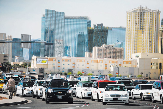 Taxicabs are stopped at a light on Tropicana Avenue before turning onto Paradise Road that leads to McCarran International Airport Wednesday, March 5, 2014, in Las Vegas. (Ronda Churchill/Las Vega ...