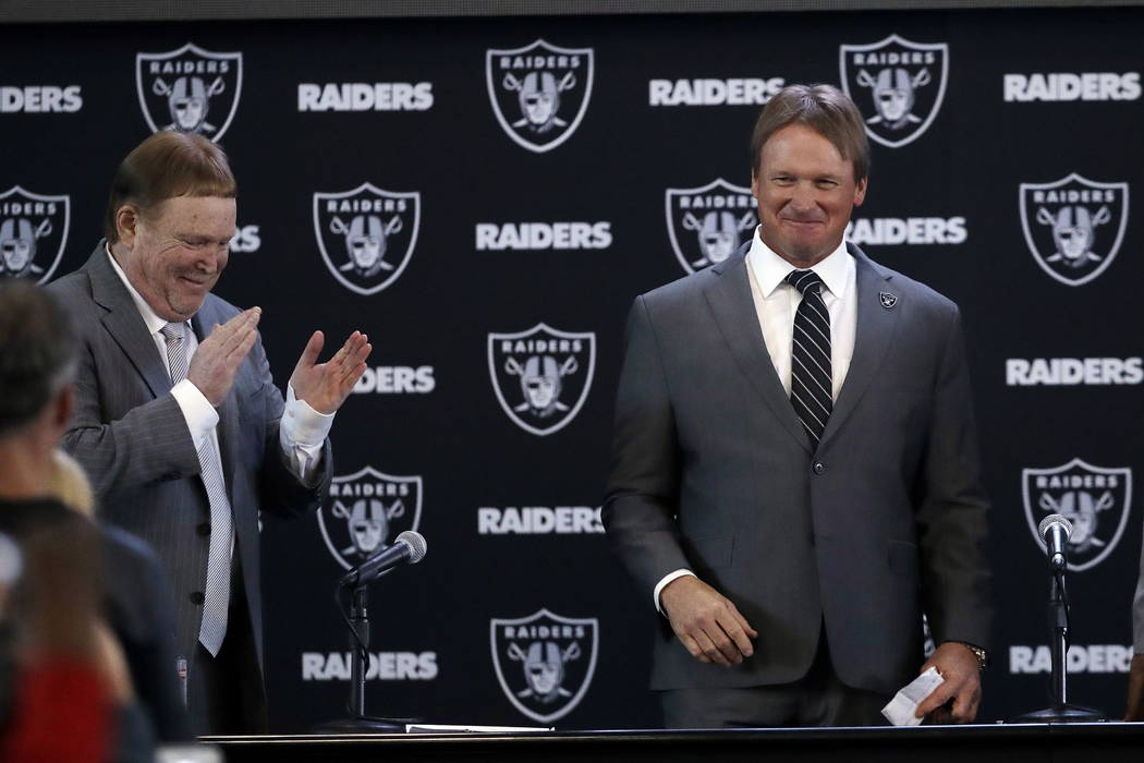 Oakland Raiders head coach Jon Gruden right smiles next to owner Mark Davis after an NFL football press conference Tuesday Jan. 9 2018 in Alameda Calif