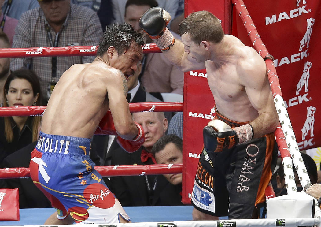Jeff Horn of Australia, right, lands a right to  Manny Pacquiao of the Philippines, during their WBO World Welterweight title fight in Brisbane, Australia, Sunday, July 2, 2017.  Pacquiao lost his ...