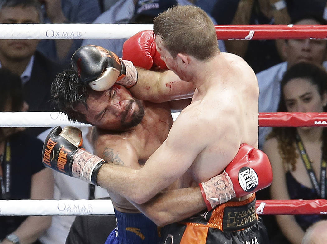 Manny Pacquiao of the Philippines, left, clinches with Jeff Horn of Australia, during their WBO World Welterweight title fight in Brisbane, Australia, Sunday, July 2, 2017. Pacquiao lost his WBO w ...