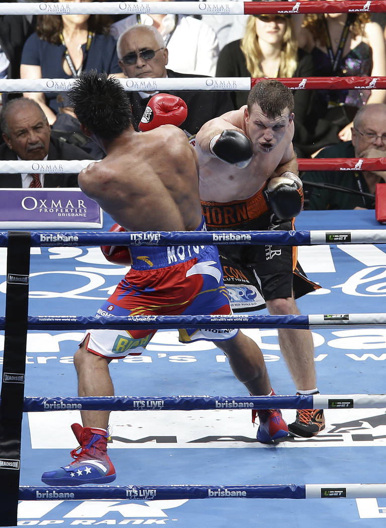 Jeff Horn of Australia, right, lands a right to Manny Pacquiao of the Philippines during their WBO World Welterweight title fight in Brisbane, Australia, Sunday, July 2, 2017. (AP Photo/Tertius Pi ...