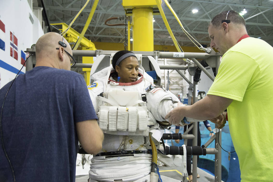 In this Sept. 16, 2014 photo provided by NASA, astronaut Jeanette Epps participates in a spacewalk training session at the Johnson Space Center in Houston. In June 2018, Epps was supposed to be th ...