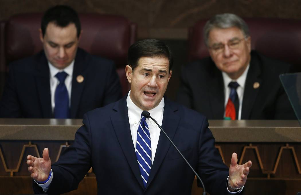 Arizona Republican Gov. Doug Ducey, center, gives his State of the State address as he is flanked by House Speaker J.D. Mesnard, left, R-Chandler, and Senate President Steve Yarbrough, right, R-Ch ...