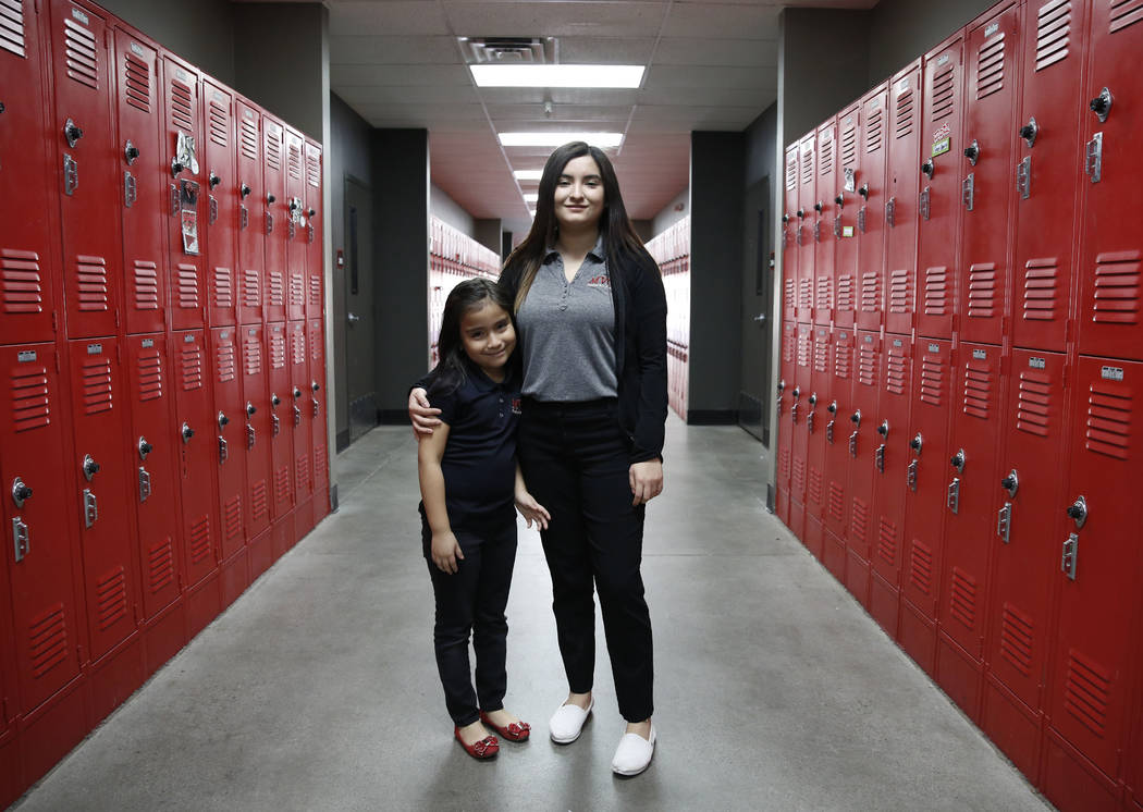 Daniela Lopez, a high school senior at Mountain View Christian School, right, poses for photo with her sister, Kiara Alvarez Vega, 6, also student at MVCS, inside their school on Tuesday, Jan. 23, ...