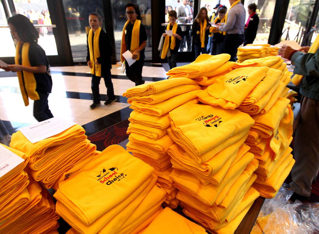 Students are given scarves as they arrive at UNLV to celebrate National School Choice Week Tuesday, Jan. 23, 2018. Over 1,800 students, teacher and families watched several student performances at ...