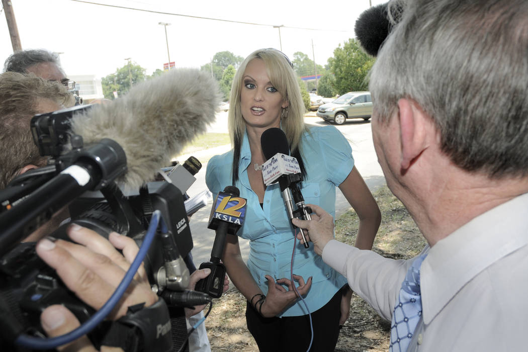 Porn star Stormy Daniels talks with the media outside of the Southfield Grill in Shreveport, La., on Friday, July 3, 2009.  At the time, she was planning to make a run against incumbent U.S. Sen.  ...