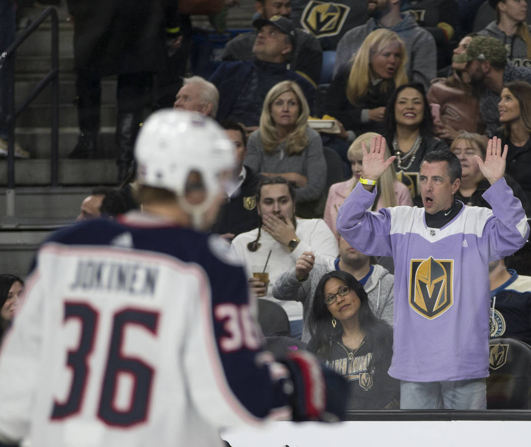 A fan watches the NHL game between the Vegas Golden Knights and the Columbus Blue Jackets at T-Mobile Arena Las Vegas, Tuesday, Jan. 23, 2018. Erik Verduzco Las Vegas Review-Journal @Erik_Verduzco