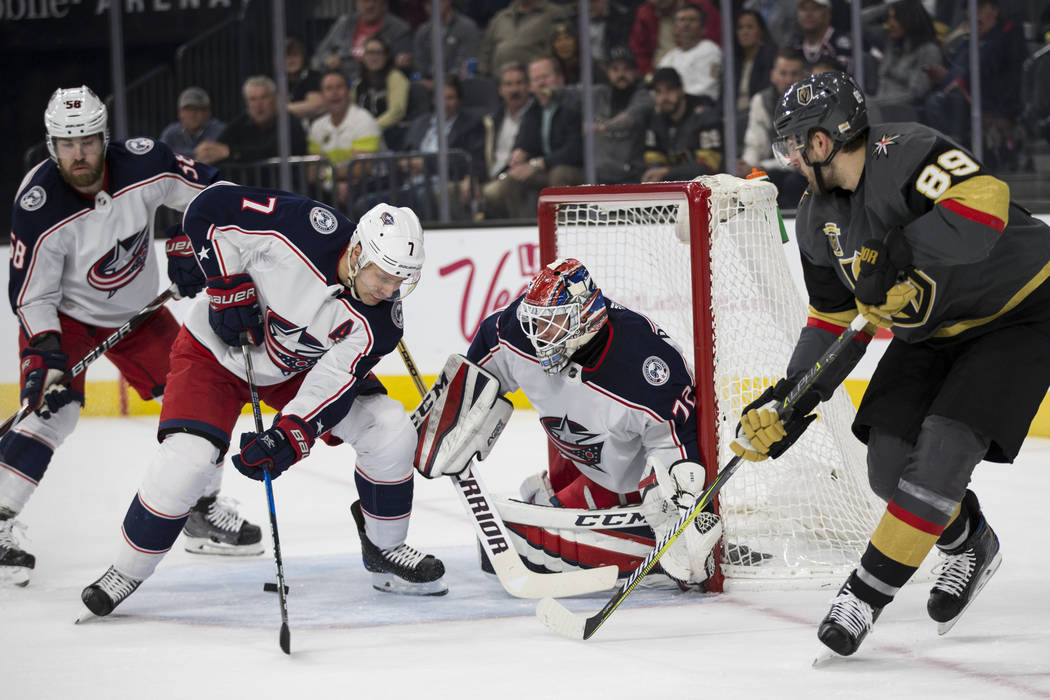 Columbus Blue Jackets goaltender Sergei Bobrovsky (72) and defenseman Jack Johnson (7) look for the puck after a shot from Vegas Golden Knights right wing Alex Tuch (89) in the NHL game at T-Mobil ...