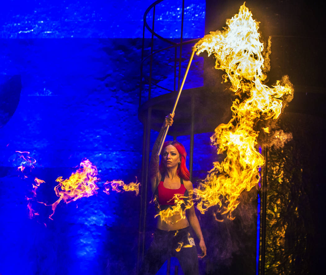 Fire dancer Teta Maria Stone, right, performs with a pyro prop during a walk through for the new show Inferno on Thursday, January 18, 2018, at Paris hotel-casino, in Las Vegas. Benjamin Hager Las ...