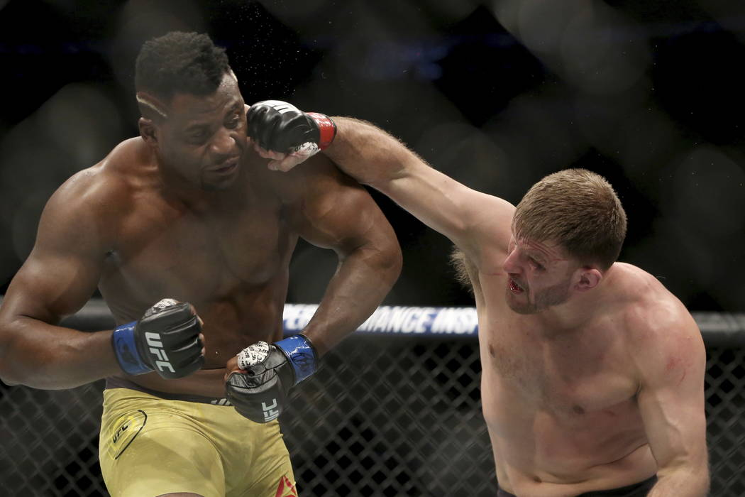 Stipe Miocic lands a right hand against Francis Ngannou during a heavyweight championship mixed martial arts bout at UFC 220, early Sunday, Jan. 21, 2018, in Boston. Miocic retained his title via  ...