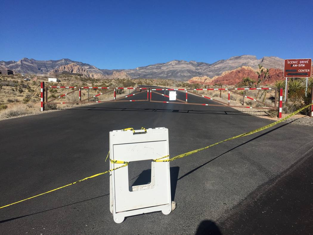 Yellow caution tape stretches across an entrance way leading to the now-closed Red Rock Canyon National Conservation Area visitors center. (Marian Green/Las Vegas Review-Journal)