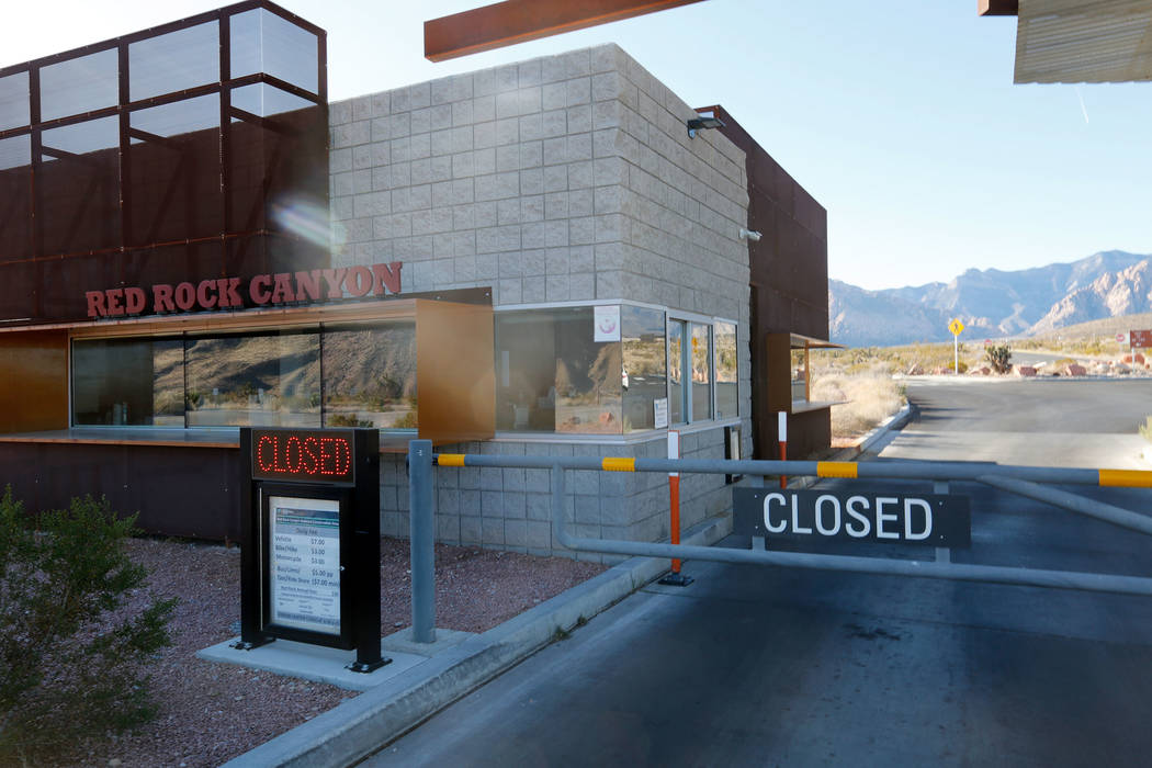 A 'closed' sign is seen at the entrance way to the Red Rock Canyon National Conservation Area visitor center in Las Vegas, Sunday, Jan. 21, 2018. The visitor center is closed because of the govern ...