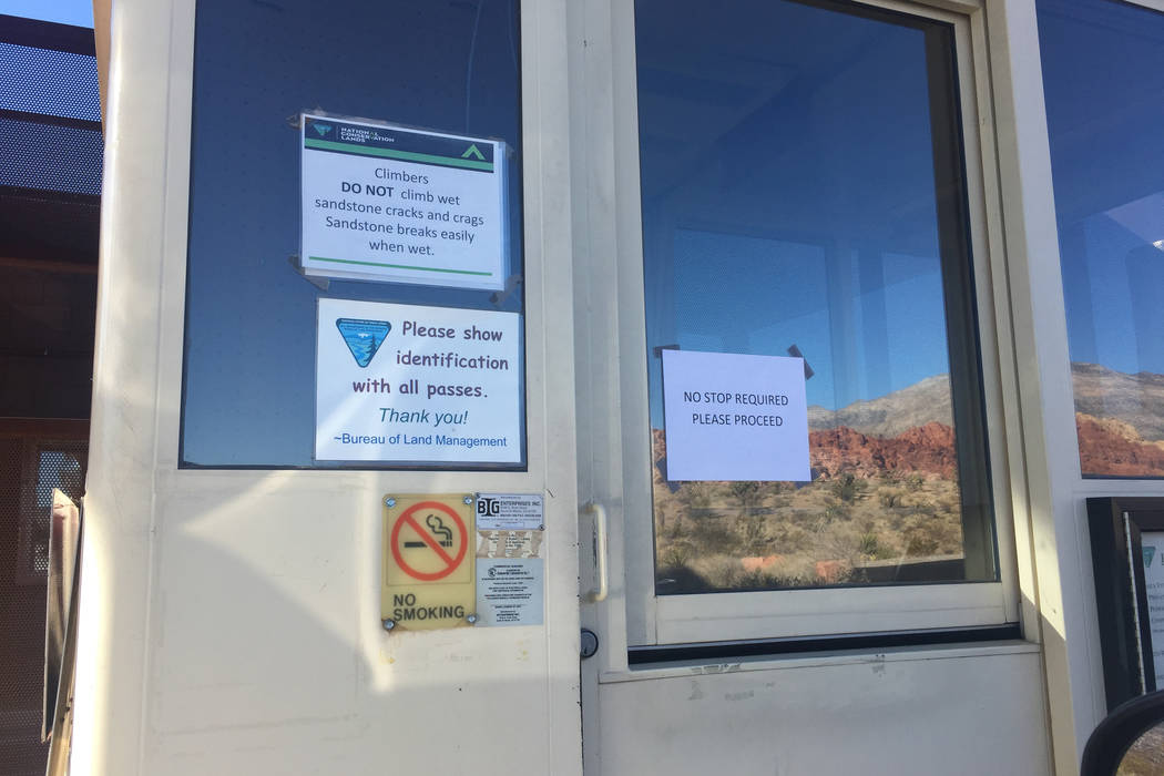 A sign posted Sunday on a fee booth at Red Rock Canyon National Recreation Area lets visitors know that they are free to proceed and no stop is necessary. (Marian Green/Las Vegas Review-Journal)