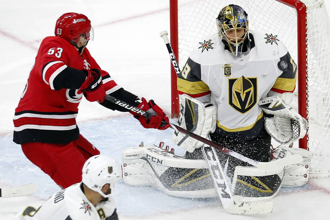 Vegas Golden Knights goaltender Marc-Andre Fleury (29) blocks a shot deflected by Carolina Hurricanes' Jeff Skinner (53) during the third period of an NHL hockey game, Sunday, Jan. 21, 2018, in Ra ...