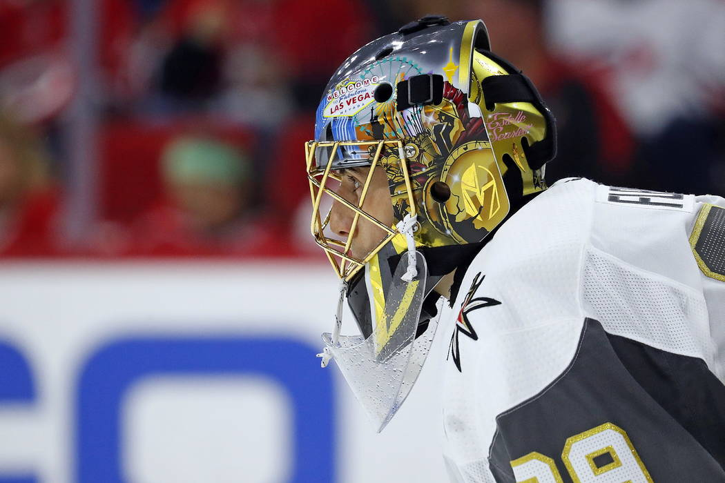 Vegas Golden Knights goaltender Marc-Andre Fleury (29) watches the second period of an NHL hockey game against the Carolina Hurricanes, Sunday, Jan. 21, 2018, in Raleigh, N.C. (AP Photo/Karl B DeB ...