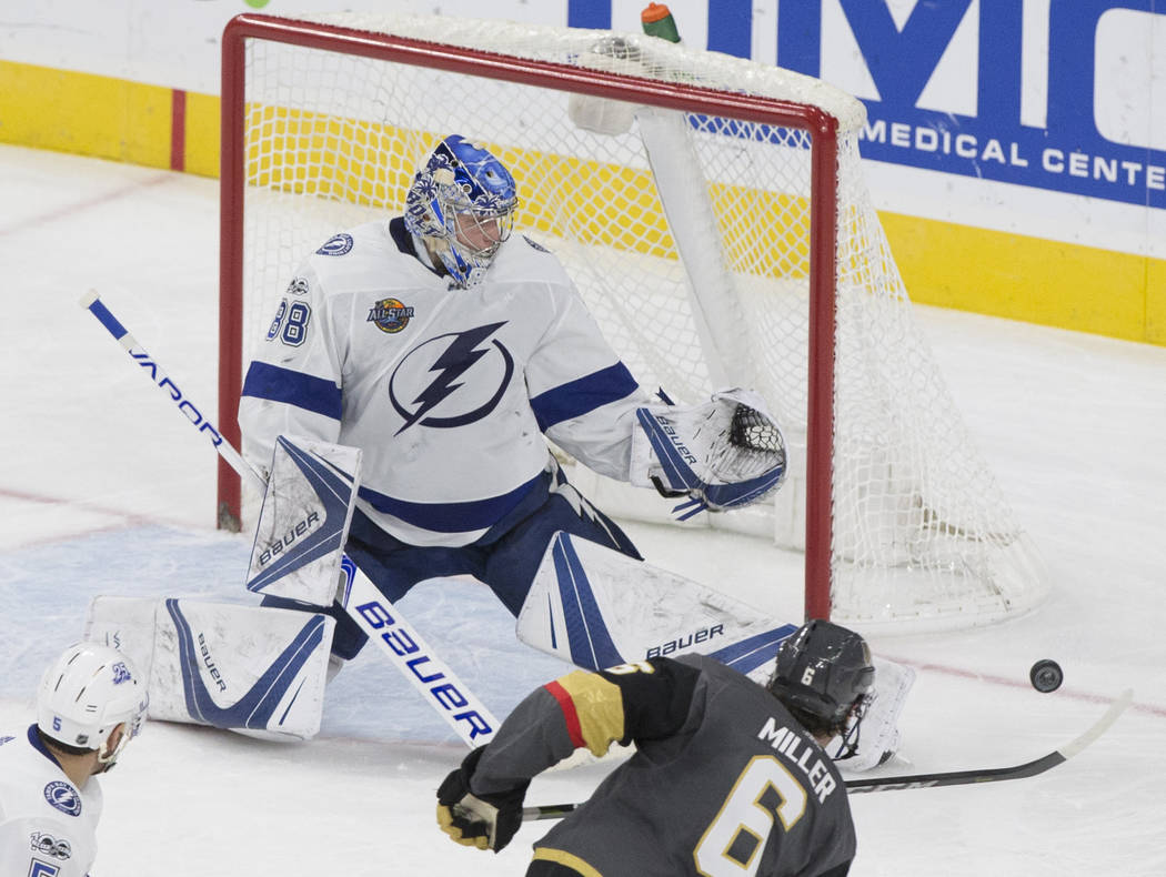 Tampa Bay goaltender Andrei Vasilevskiy (88) makes a save against Golden Knights defenseman Colin Miller (6) in the second period during the Lightning's road matchup with Vegas on Tuesday, Dec. 19 ...