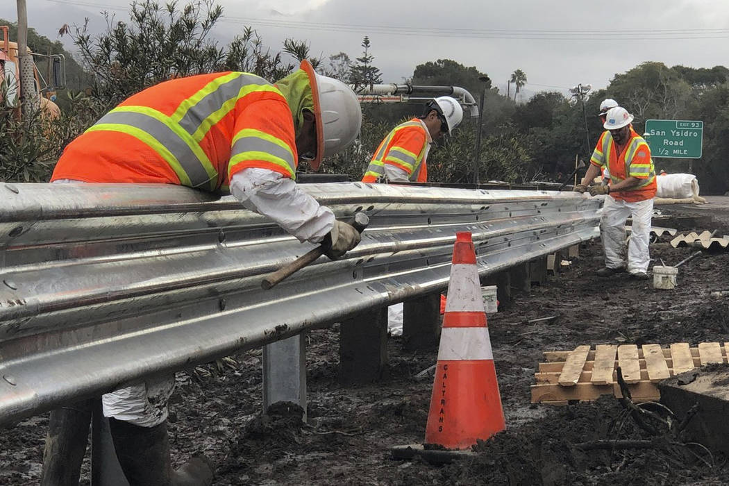 Caltrans workers continue their around-the-clock efforts Friday to clean-up and repair the damaged section of US 101 in Montecito, Calif., on Friday, Jan. 19, 2018, that was closed following flood ...
