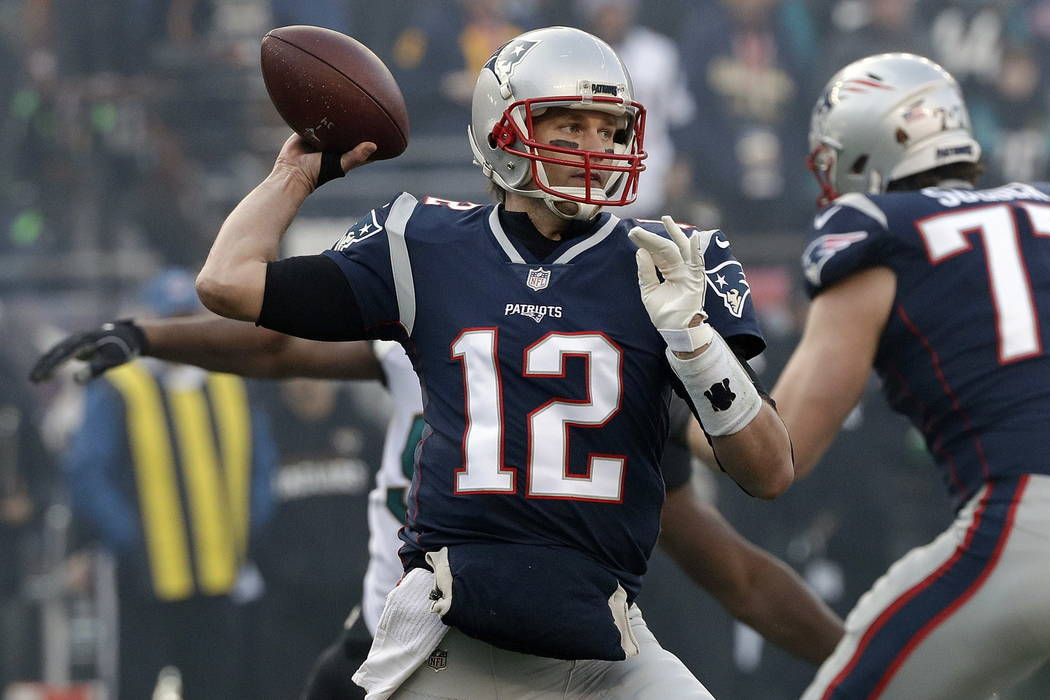 New England Patriots quarterback Tom Brady throws a pass during the first half of the AFC championship NFL football game against the Jacksonville Jaguars, Sunday, Jan. 21, 2018, in Foxborough, Mas ...